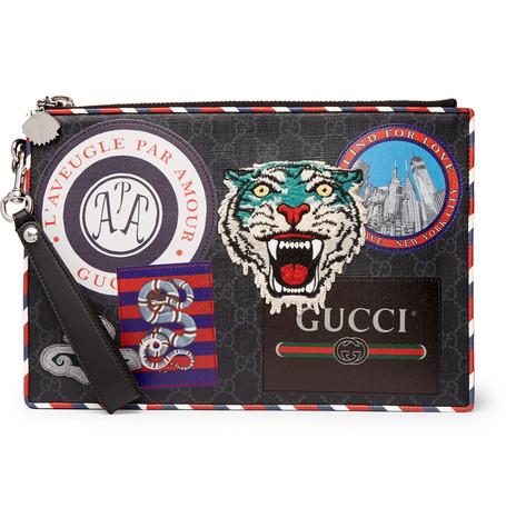 6de25e62dac6d5 GucciNight Courier Leather-Trimmed Appliquéd Monogrammed Coated-Canvas Pouch