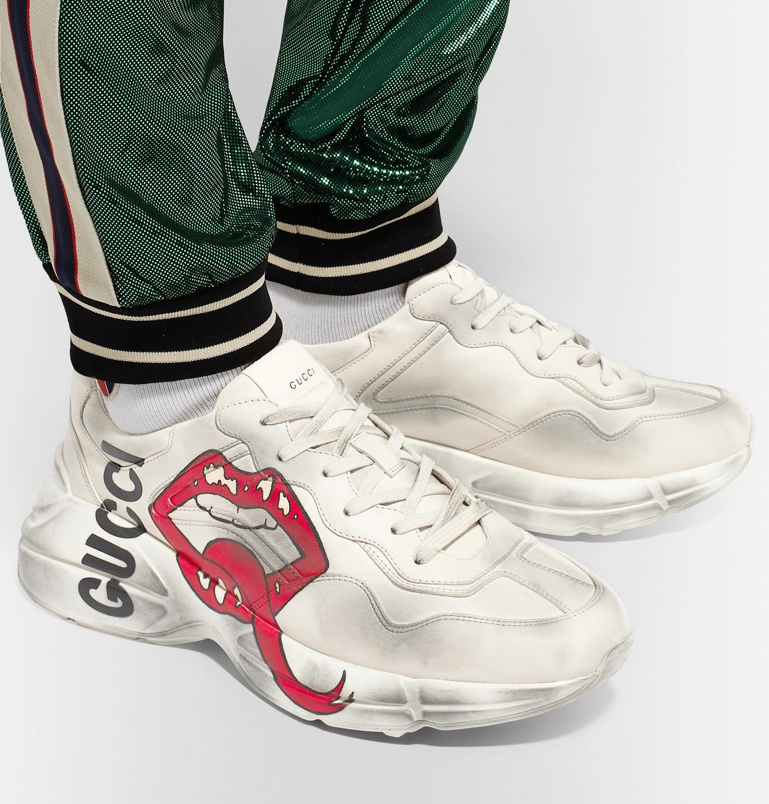 c7b625b6b0c Gucci - Rhyton Printed Distressed Leather Sneakers