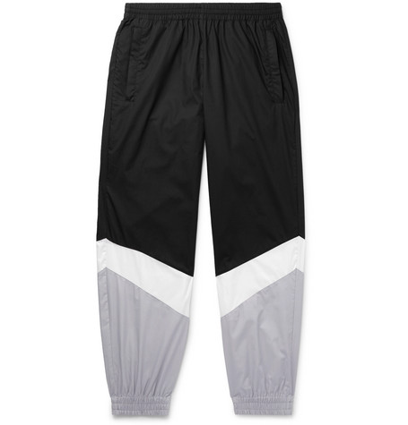 Tapered Panelled Coated Cotton Sweatpants by Vetements