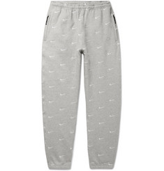 Nike NRG Tapered Logo-Embroidered Mélange Fleece-Back Cotton-Blend Jersey Sweatpants