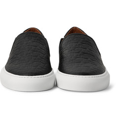 Givenchy - Star-Embossed Leather Slip-On Sneakers
