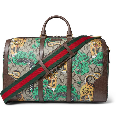 gucci male gucci leathertrimmed printed coatedcanvas holdall brown