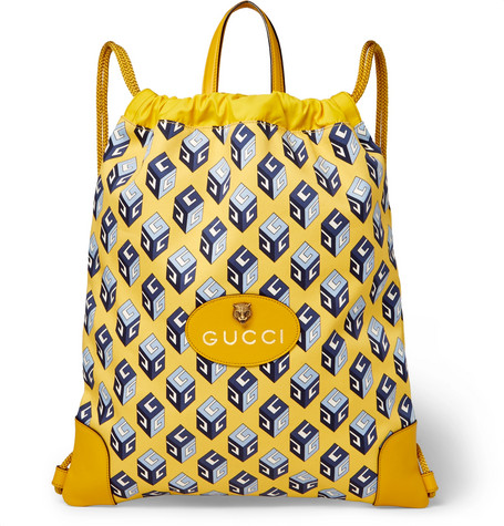 Leather-trimmed Printed Canvas Drawstring Backpack - Yellow