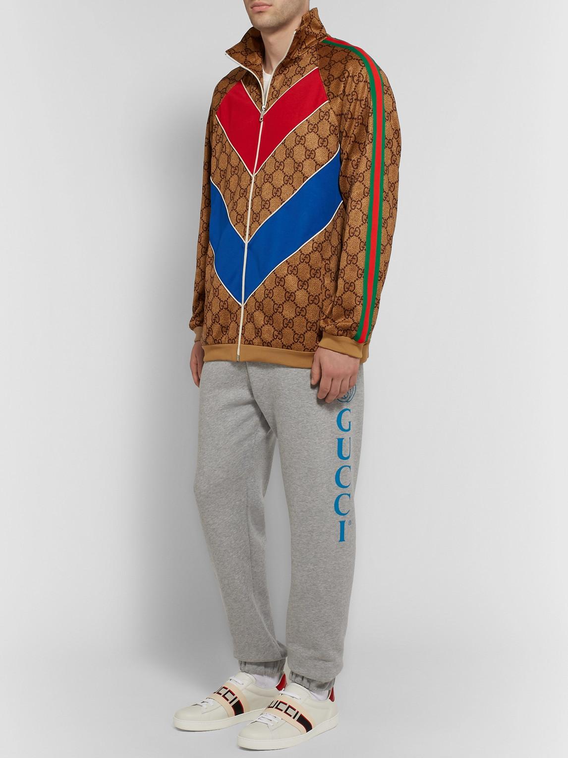 Gucci Pants TAPERED LOGO-PRINT LOOPBACK COTTON-JERSEY SWEATPANTS
