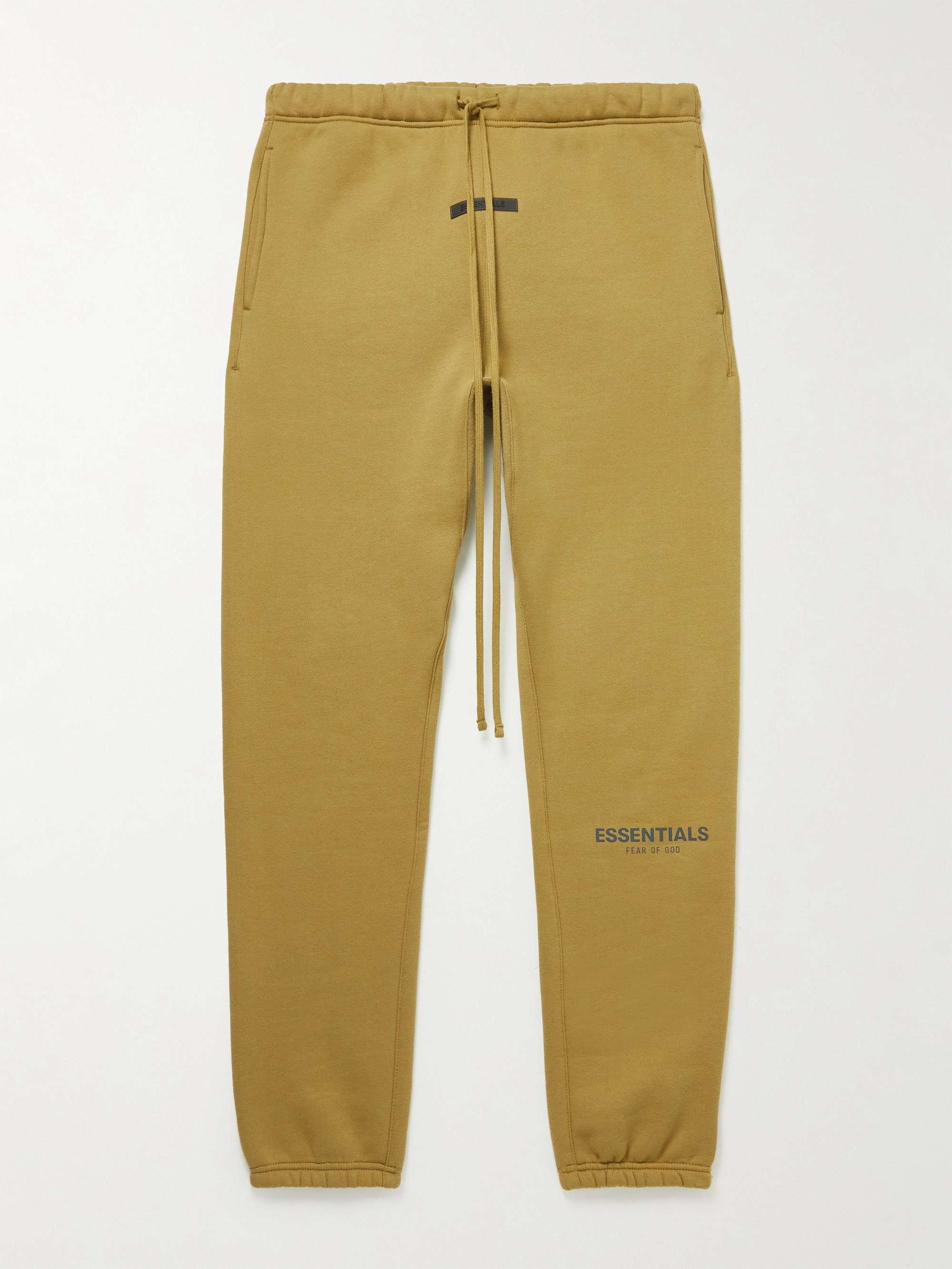 피어오브갓 에센셜 21FW 스웨트팬츠 FEAR OF GOD ESSENTIALS Tapered Logo-Print Cotton-Blend Jersey Sweatpants,Mustard