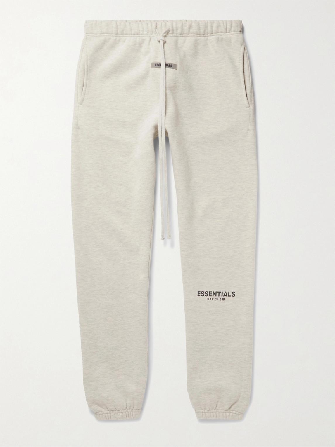 Fear Of God Essentials Tapered Logo-appliquÉd MÉlange Fleece-back Cotton-blend Jersey Sweatpants In Gray