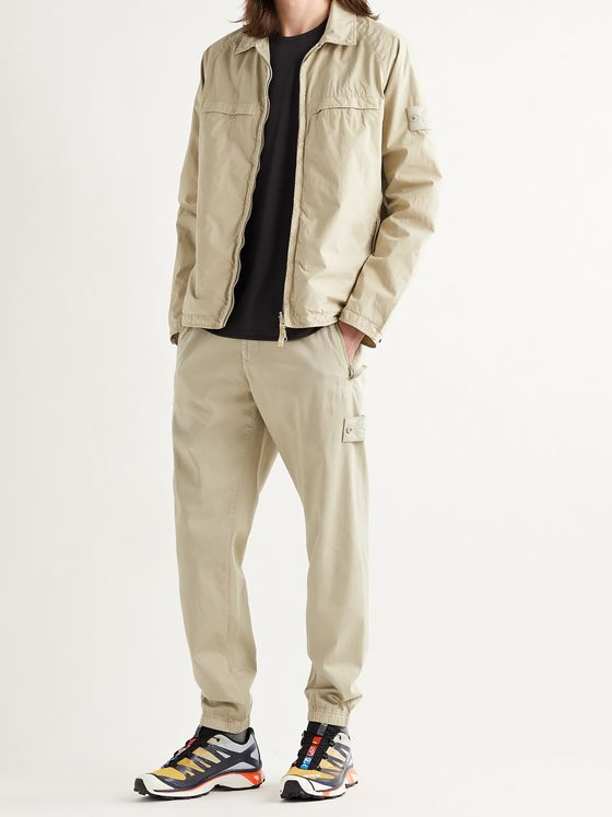 STONE ISLAND Ghost Tapered Logo-Appliquéd Cotton-Blend Trousers