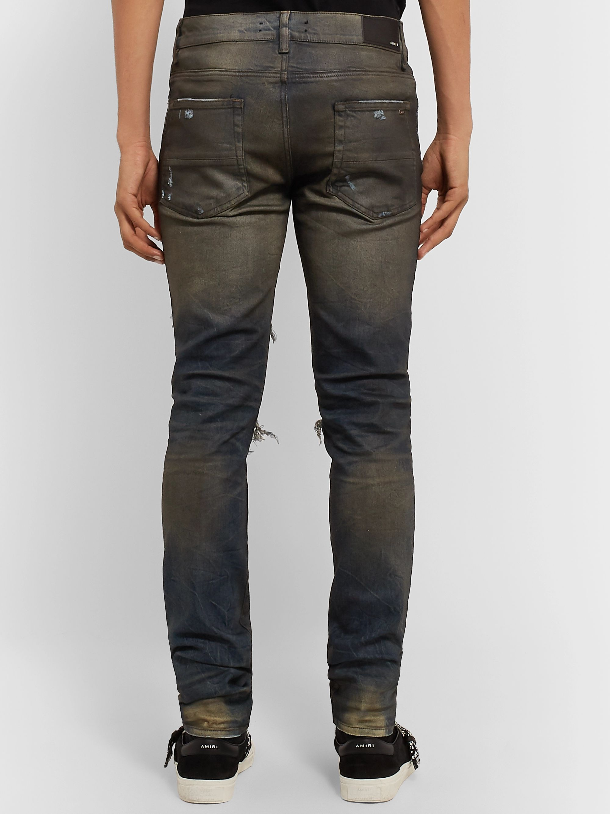 AMIRI Skinny-Fit Cashmere-Panelled Distressed Stretch-Denim Jeans