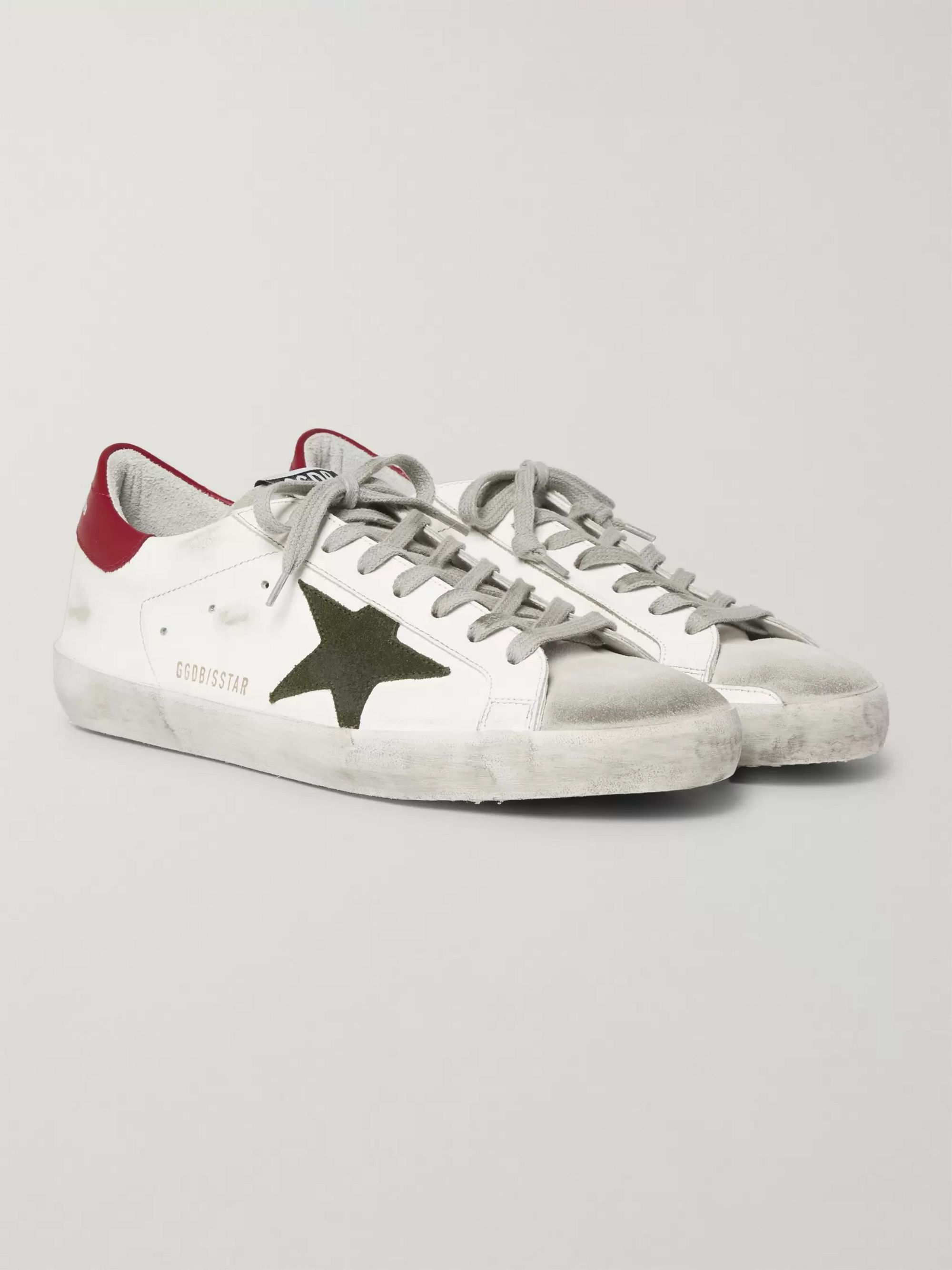 più recente a3429 6a912 Superstar Distressed Leather and Suede Sneakers