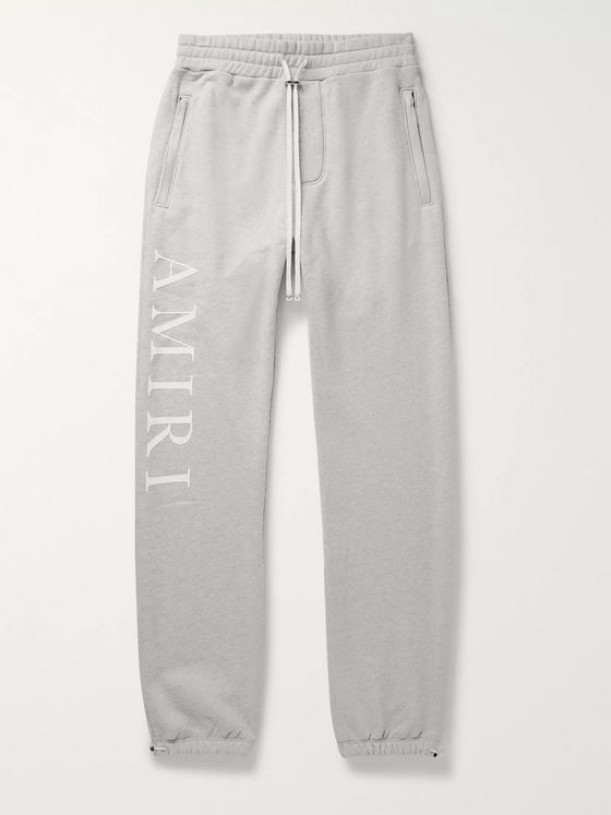 AMIRI Tapered Logo-Print Mélange Loopback Cotton-Jersey Sweatpants