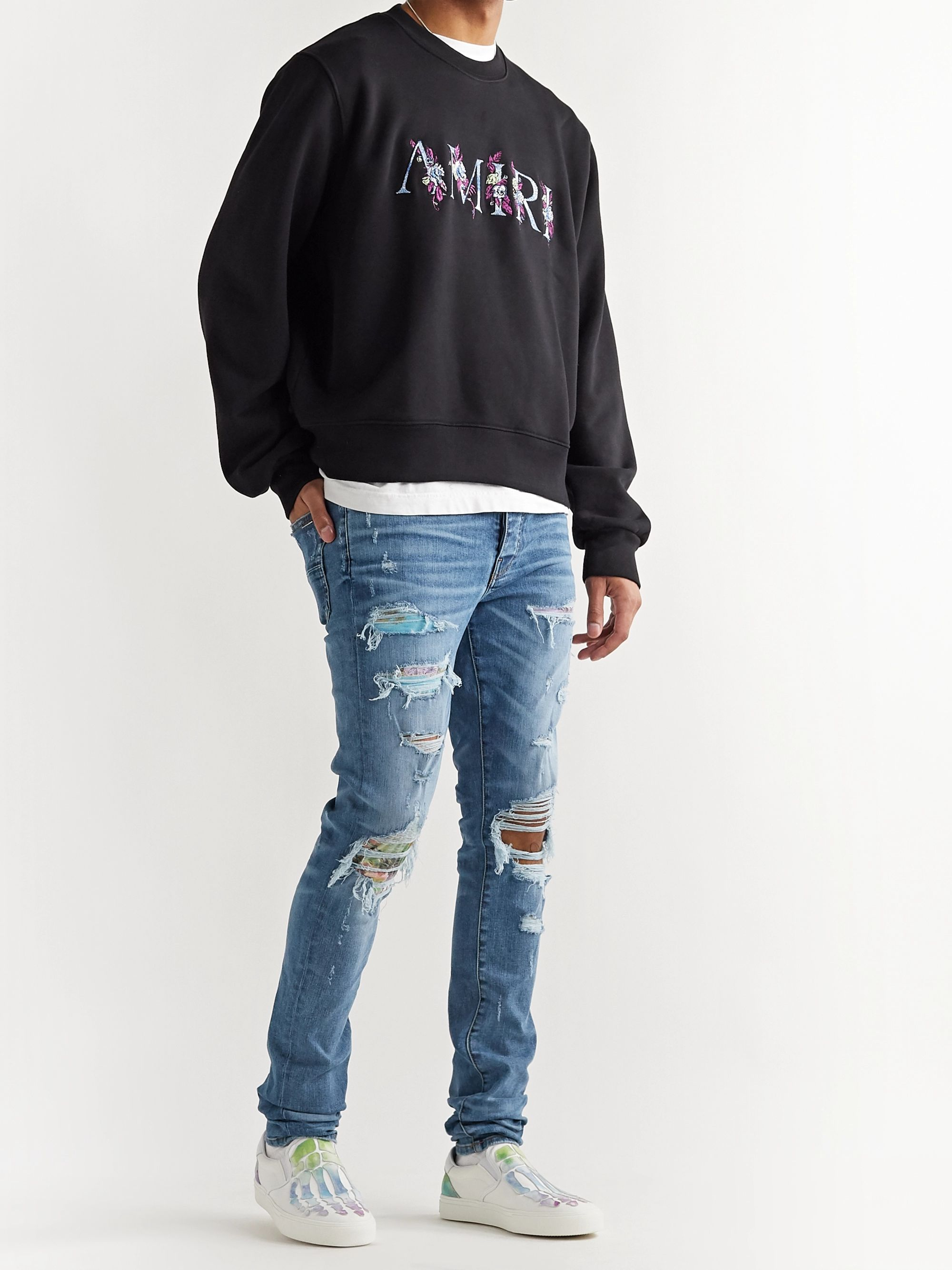 AMIRI Skinny-Fit Distressed Panelled Stretch-Denim Jeans